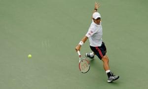 Kei Nishikori of Japan returns a shot.