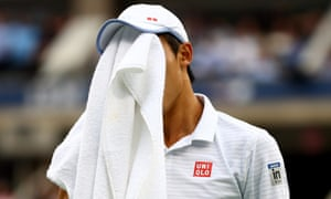 Kei Nishikori of Japan wipes his face