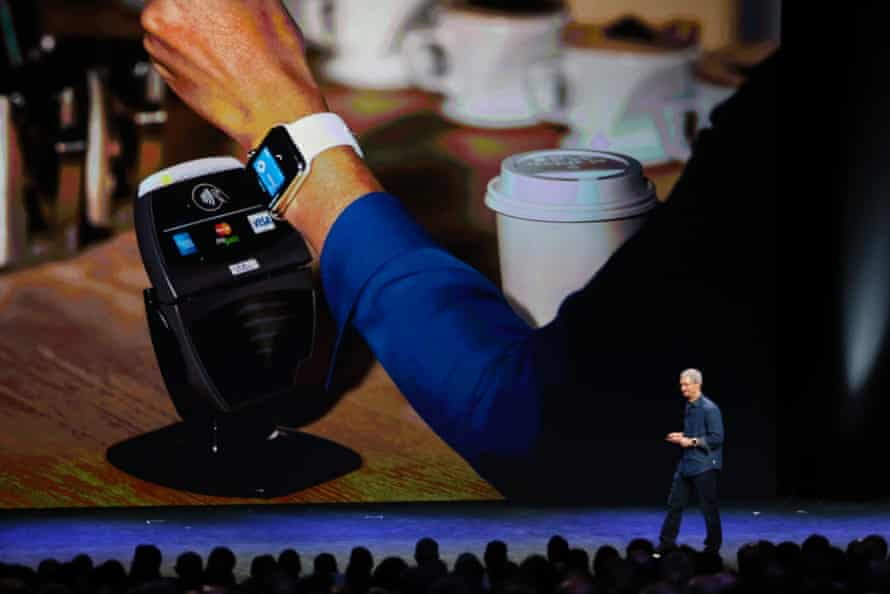 Apple CEO Tim Cook demonstrates the Apple Pay system using an Apple Watch