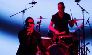 U2 members Bono, left, and Larry Mullen Jr. playing the Apple event on Tuesday.