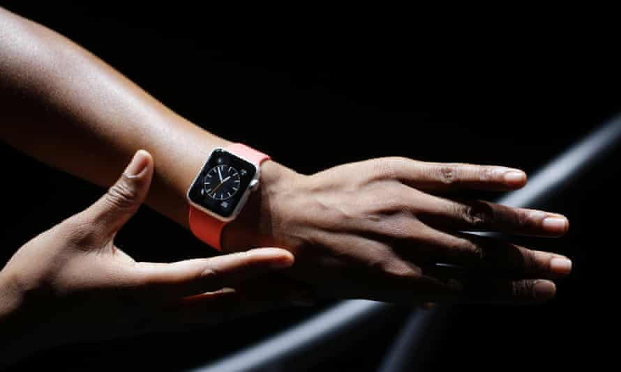 The new Apple Watch is shown by a model on a treadmill during a new product release on Tuesday, Sept. 9, 2014, in Cupertino, California