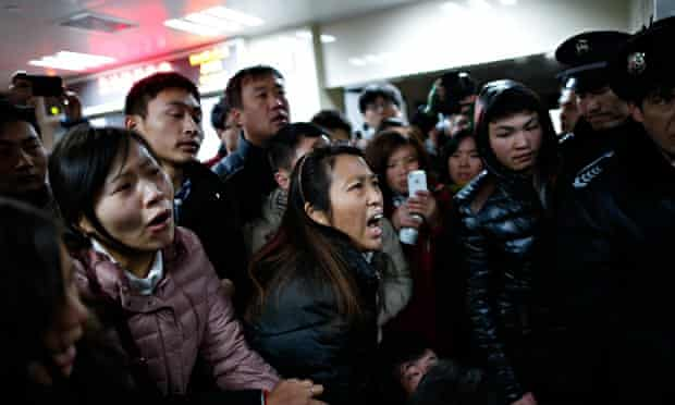 Relatives arrive at the hospital where the injured were taken following a stampede on New Year's eve