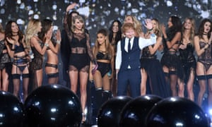 Ed Sheeran poses with singers Taylor Swift and Ariana Grande and Victoria's Secret models at a London fashion show in December 2014.