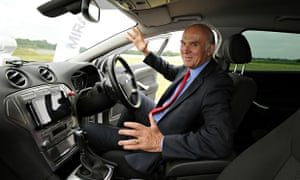 Business secretary, Vince Cable, sits in a driverless car