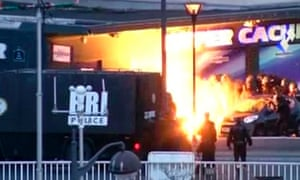 An explosion lights the front of a kosher supermarket as French police special forces launch their assault to free hostages.