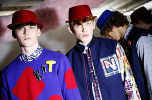 Models in pork pie hats wait backstage before the Kit Neale show