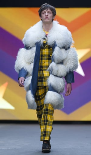 A model in fun faux fur on the catwalk for Topman Design