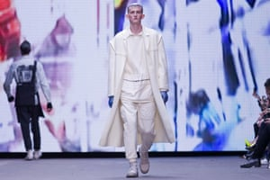 A model in head to toe cream on the Liam Hodges catwalk