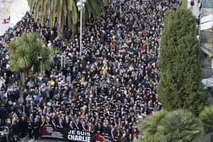"Thousands of people, some holding up signs that read, ""Je suis Charlie"", march during a rally along the sea front in the Mediterranean city of Nice."