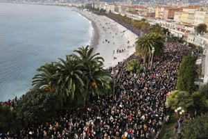 Thousands of people march during a rally along the sea front in Nice.