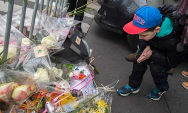 A boy pays tribute to the victims of a hostage-taking at the Hyper Cacher kosher supermarket near Porte de Vincennes in eastern Paris.