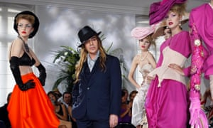 Galliano in his heyday with Christian Dior, at the finale of his Paris fashion week show in 2009.