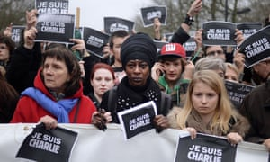 "People hold signs reading ""Je Suis Charlie"" (I am Charlie) and hold up pens during a march attended by an estimated 75,000 in Nantes, western France."