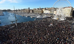 People march during a demonstration attended by an estimated 45,000 on the old harbour in Marseille, southern France.