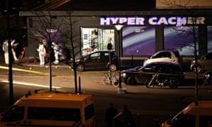 Officers outside the Hyper Cacher supermarket in Paris after the police raided the store