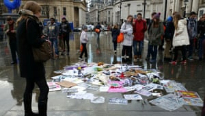 Pens, candles and placards left after the #JeSuisCharlie vigil