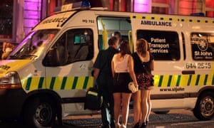 Revellers talk to a friend being treated in an ambulance outside a Cardiff night spot.