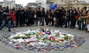 People adding to the pen circle in Trafalgar square, London on Sunday 11 January, as a tribute to those who lost their life in the Paris attacks