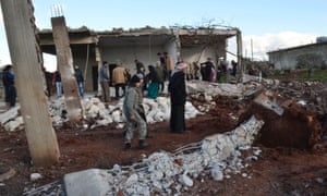 Civilians inspect a site hit by what activists said were air strikes by forces loyal to Syria's President Bashar al-Assad in Jabal al-Zawiya in the southern countryside of Idlib on 4 January 2015.