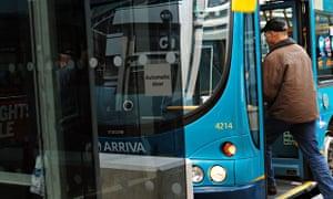 A man boards a bus in Derby