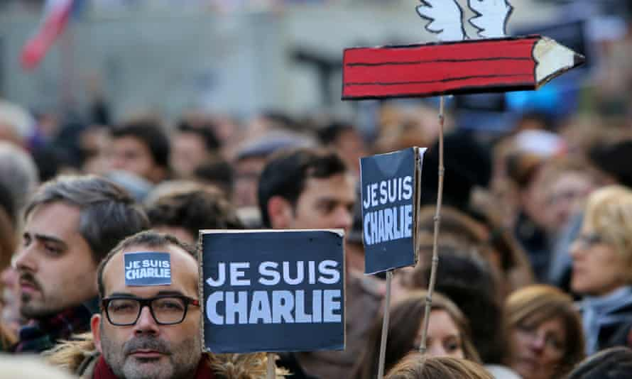 """A man holds a placard reading """"Je suis Charlie"""" (I am Charlie) during the rally."""