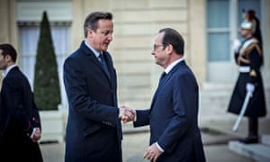 David Cameron greets President Hollande of France before the unity rally in Paris