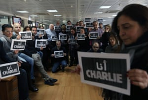 Nicosia, Cyprus: Journalists from press agency Agence France-Presse (AFP) hold signs reading Je suis Charlie at the agency's Middle East and north Africa headquarters.