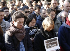 Tokyo, Japan French residents in Japan offer silent prayers at a special memorial gathering at the French Institute.