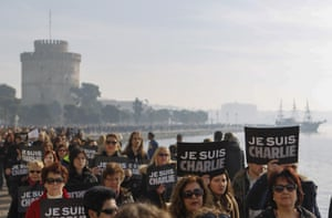 Thessaloniki, Greece People hold 'Je Suis Charlie' placards, pencils and pens as they gather at a vigil to show support for the victims of the French terror attacks in front of The White tower.