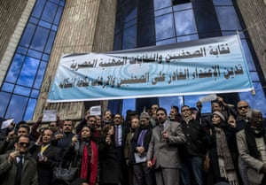 Egyptian journalists hold up pens in a silent protest outside Egypts syndicate of Journalists to protest against the attack on the French satirical magazine Charlie Hebdo's office in Paris which killed 12 people.