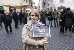 """Rome, Italy A woman holds a sign  """"Je Suis Charlie"""" (I am Charlie) signs as several hundred people gather in solidarity with victims of two terrorist attacks in Paris in front of the French Embassy"""