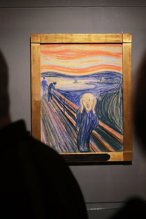 People look at Edvard Munch's 'The Scream' in Manhattan's Museum of Modern Art (MOMA) in New York.