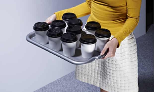 Intern carrying tray of coffee and tea