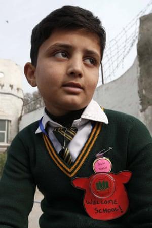 A schoolboy leaves the Army Public School