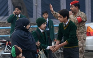 A other drops her children at the Army Public School this morning