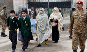 Parents leave the Army Public School with their children at the end of the day