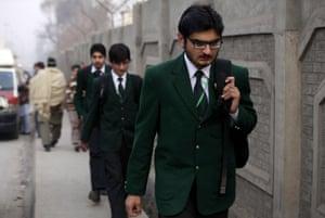 Schoolchildren arrive at the Army Public School