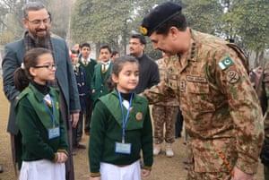 Pakistani Army chief Raheel Sharif greets Army Public School pupils.