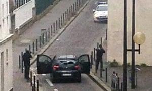 Armed gunmen face police officers