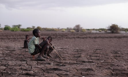 Children sitting on the Omo River bank which is slightly cracked due to the lowering of water level. Gibe III Dam, Africa's Tallest Dam with installed capacity of 1870 MW which is under construction, is said to impact 500,000 Ethiopians and Kenyans relying their lives on Omo River and Lake Turkana. The lowering of water level and the change of water salinity may especially impact aboriginal tribes who already live in severe drought and poverty, and may end the fragile peace between tribes