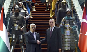 Recep Tayyip Erdoğan, right, shakes hands with his Palestinian counterpart Mahmoud Abbas