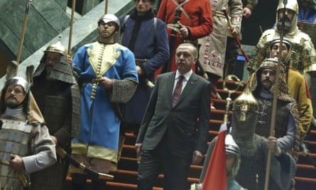 Turkish president Recep Tayyip Erdogan walks between the guards wearing Turkish warriors' costumes.