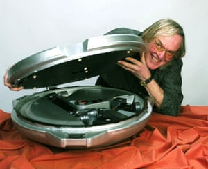 Colin Pillinger with a model of Beagle 2.