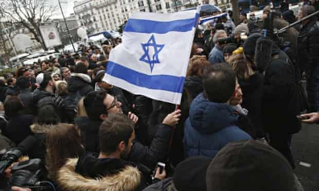 A man waves an Israeli flag during Benjamin Netanyahu's visit to Paris on 12 January 2015.