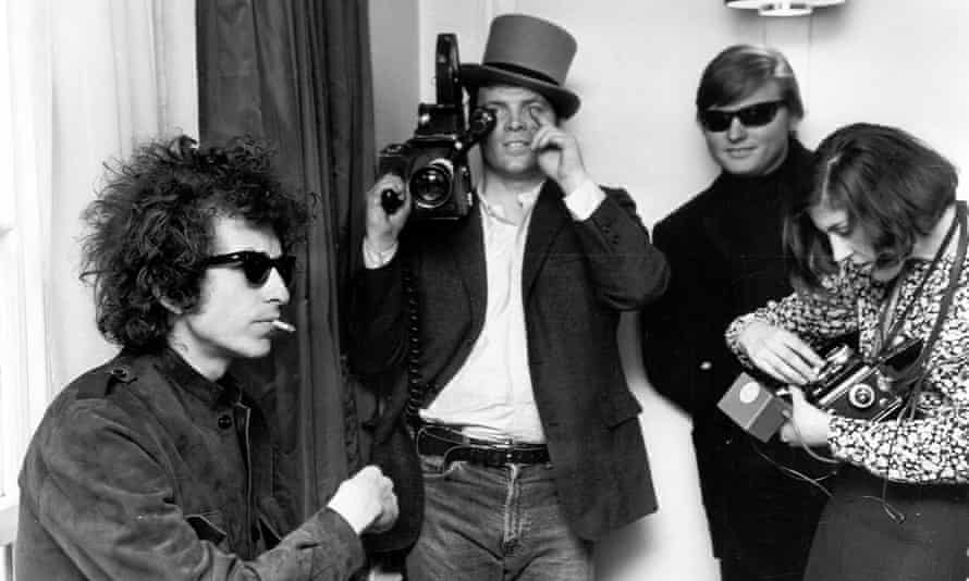 Dylan with film-maker DA Pennebaker in the background shooting the documentary Don't Look Back.