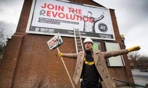 Bez from Happy Mondays unveiling his first election campaign poster on the side of a newsagent's shop in Salford, Greater Manchester, where he is standing for the Reality Party in May's general election. The seat is currently held by Labour's Hazel Blears, who is stepping down.