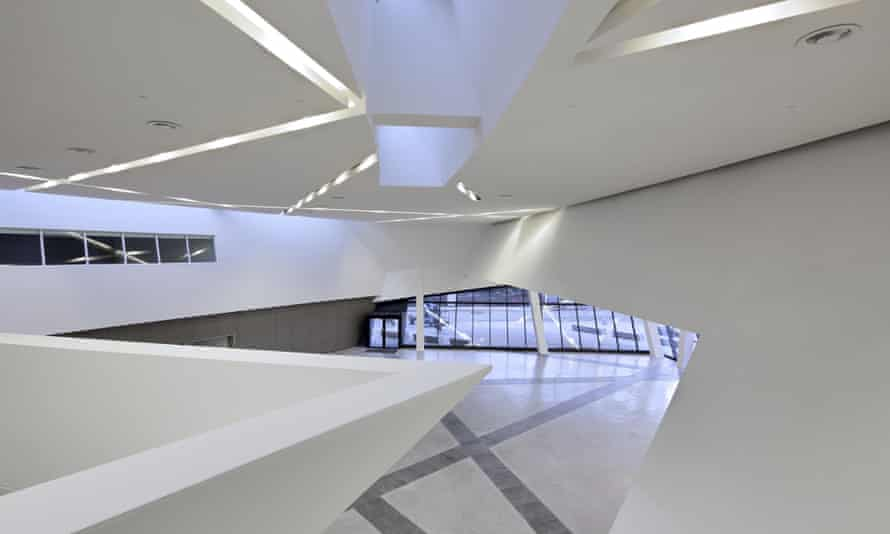 The interior of Libeskind's conference centre is punctuated by slanting staircases and criss-crossing lighting tracks.