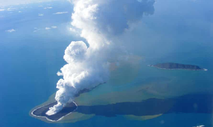 An aerial photo of ash rising into the air from Hunga Ha'apai in 2009.