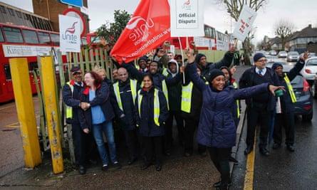 Metroline bus drivers picket outside of Willesden bus depot in north west London.