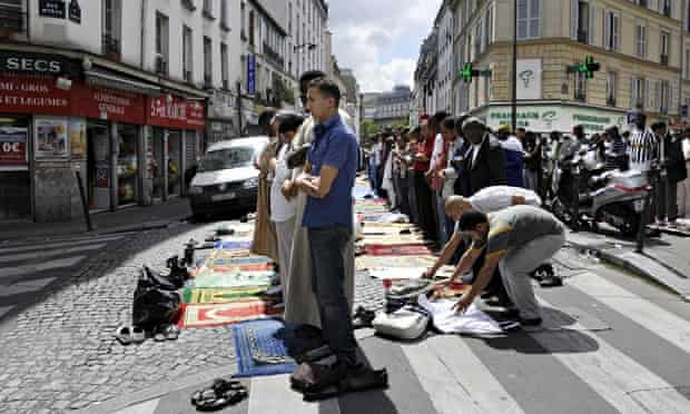 Muslims pray outside a mosque in Paris in 2011